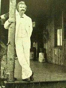 Mark Twain standing small